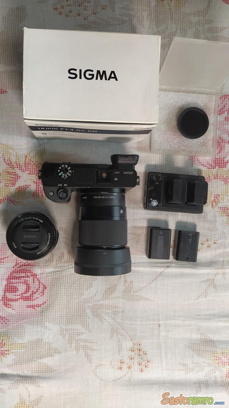 Sony A6400 camera + Sigma lens 30mm f/1.4 + Sony 16-50mm f/3.5-5 kit Lens+