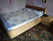 Queen size bed with clothes storage and side drawer