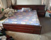 Double sized bed with bed side table attached